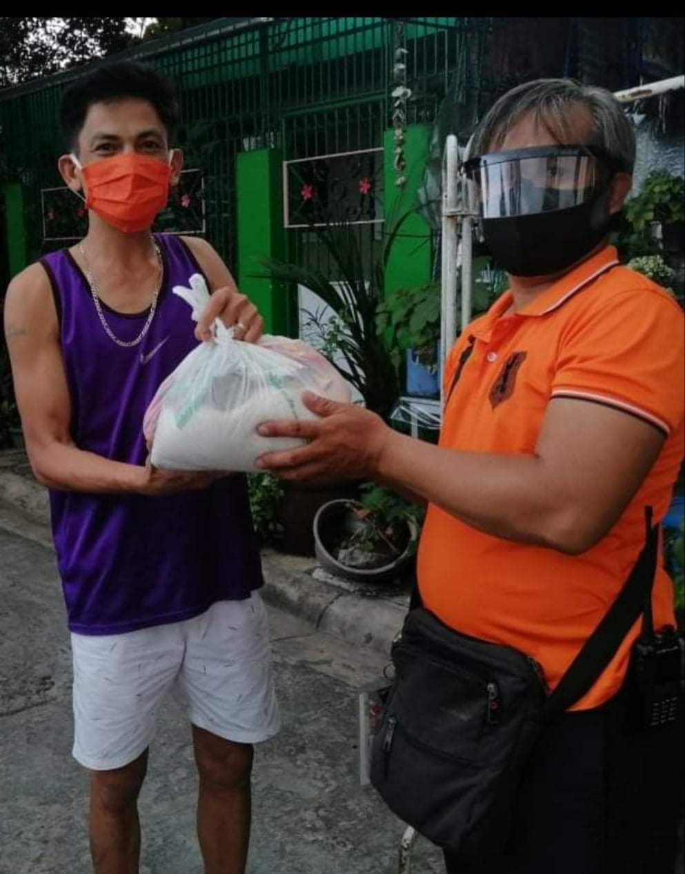 The Official Maharlika Association distributes food aid, free masks to affected barangay area