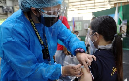 More Filipinos urged to get Covid-19 vaccines during ECQ
