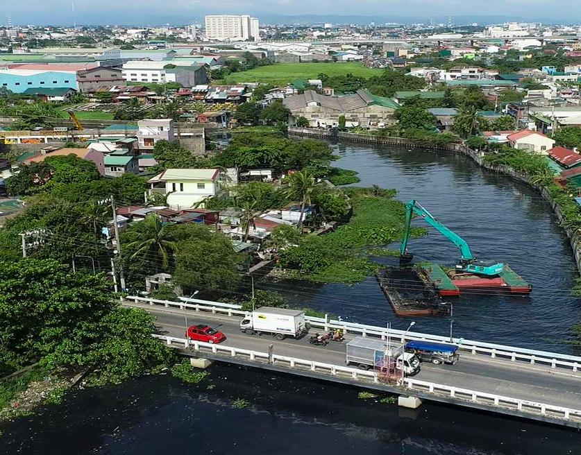 SMC sets a higher target for Tullahan River cleanup; project breaches 400k MT of solid wastes removed