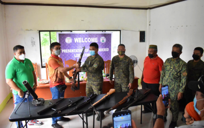 Maguindanao town execs present loose firearms to military