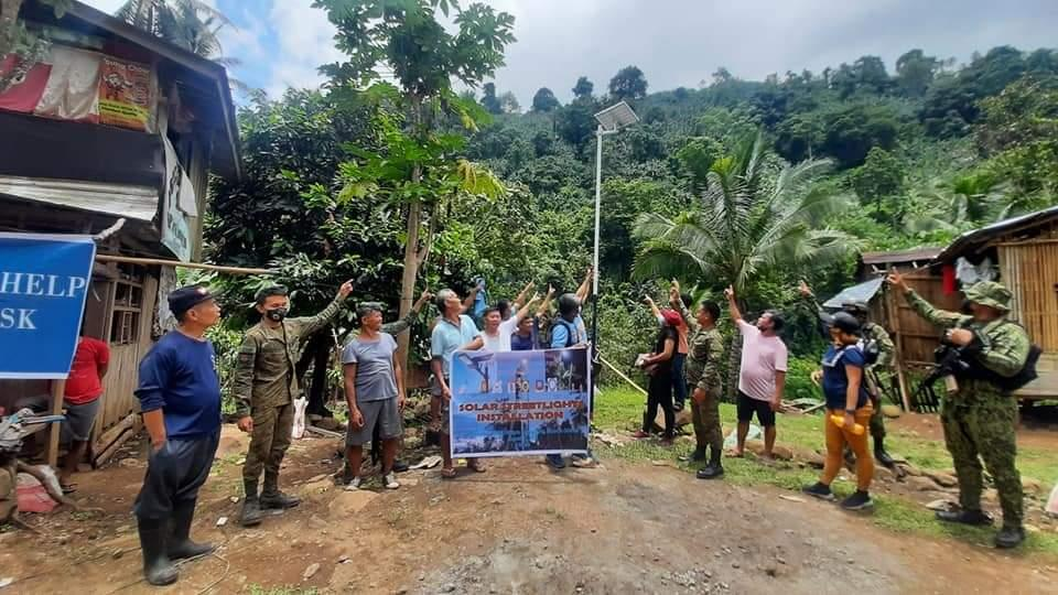 Cops provide solar lights to residents in MisOr