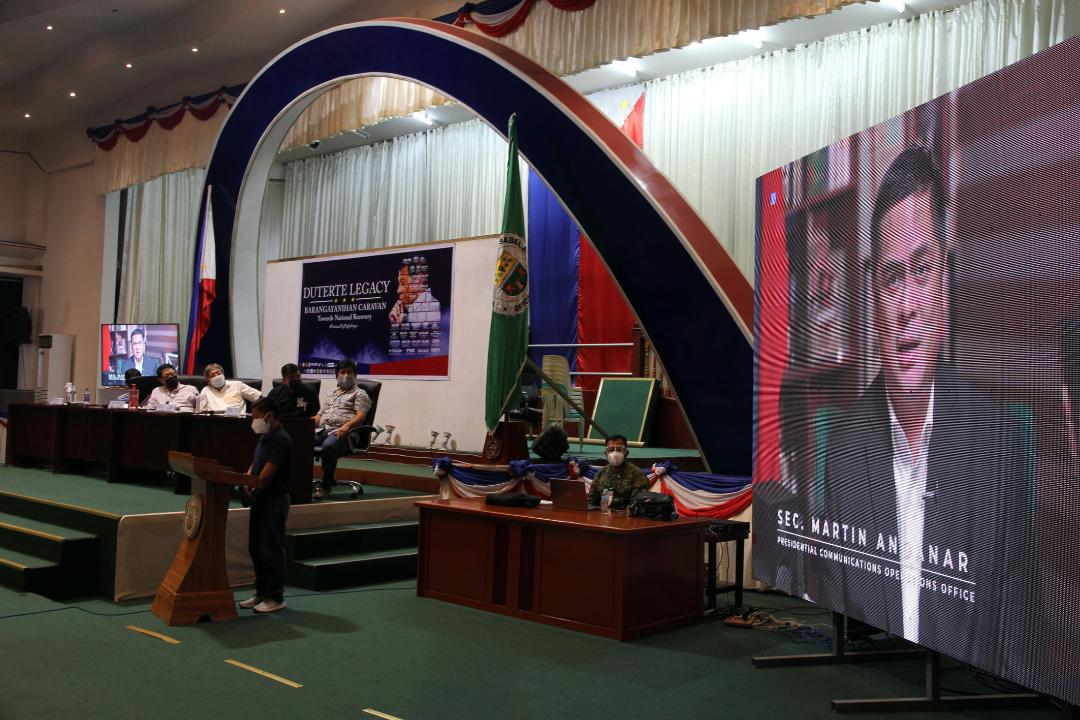 Bello, local executives watch Andanar deliver video message at 'The Duterte Legacy: Barangayanihan Caravan Towards National Recovery' event launch in Ilagan City