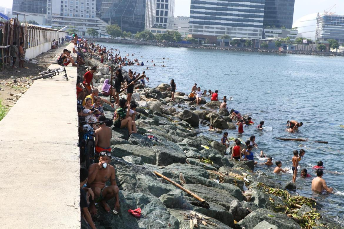 People go for a swim at 'safer' Manila Bay